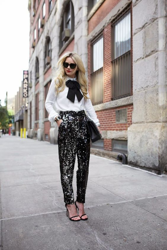 White Full Sleeves Shirt With Bow On Front Paired With Black Sequin Bottom