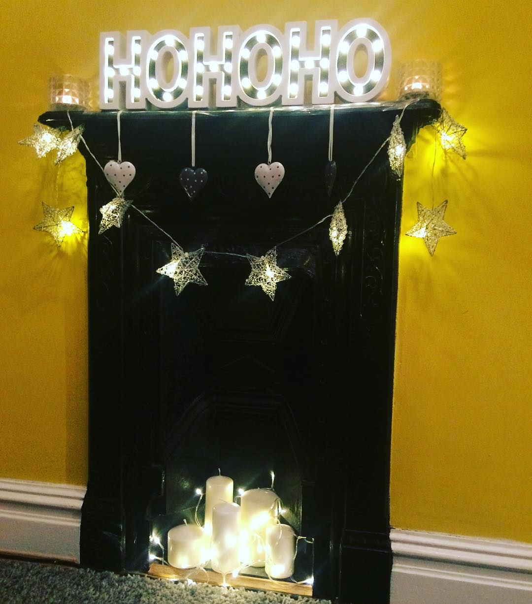 Yellow And Grey HO HO With Stars Garland And Candles