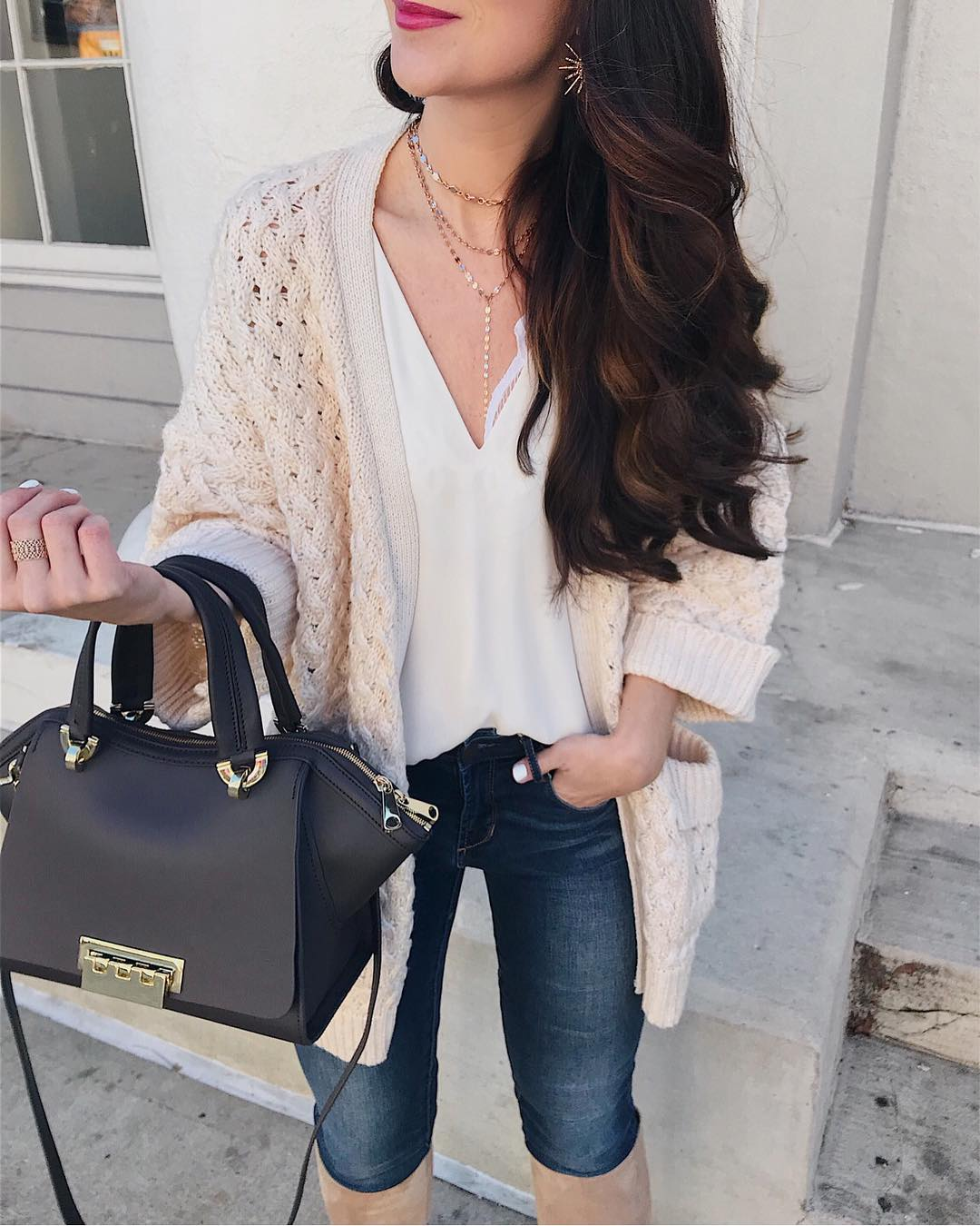 Adoring Knit Cardigan With V-Neck White Top Jeans And Beautiful Handbag