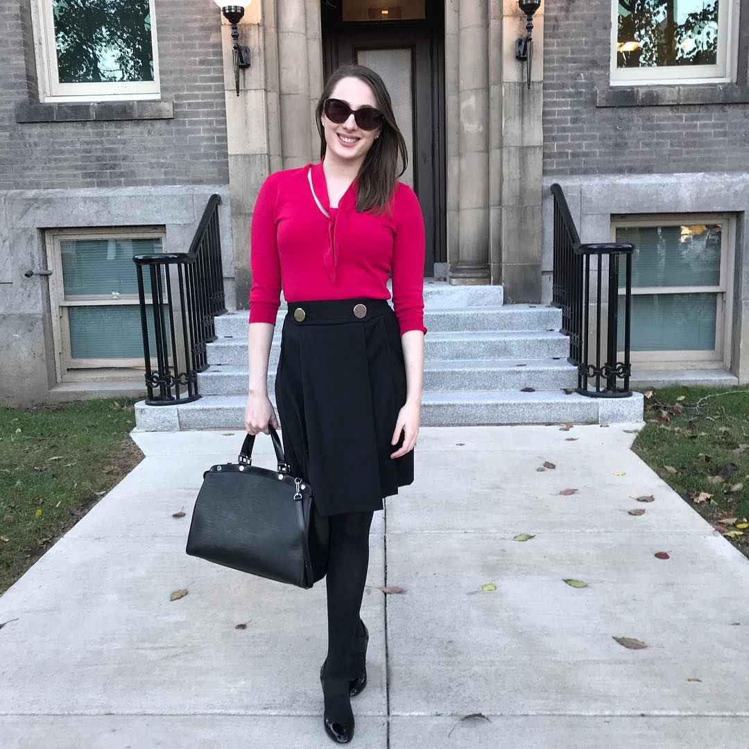 Alluring Dark Pink Top With Black Skirt And Handbag