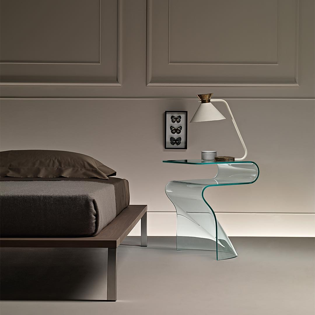 Attractive Single Piece Curved Glass Table Looks Fabulous In Contemporary Bedroom