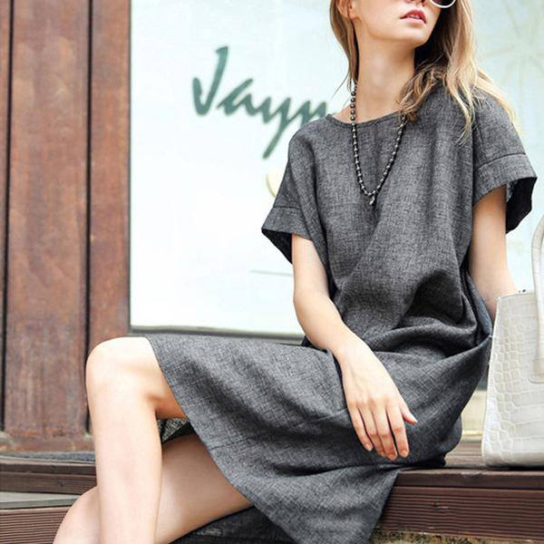 Elegant Grey Outfit With Pearl Necklace
