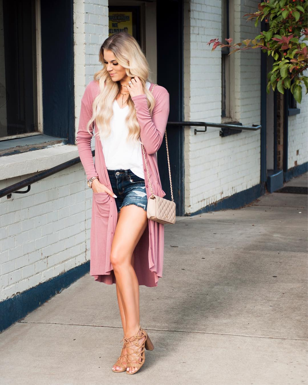 Glamorous Pink Long Cardigan Paired With White Top And Denim Shorts