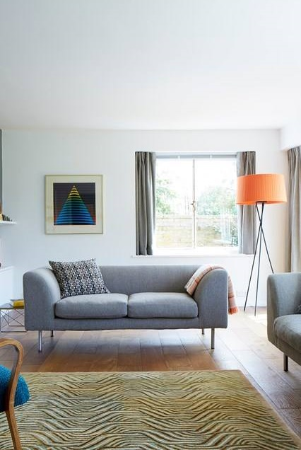 Mind-Blowing White Living Room with Grey Sofa And Orange Lampshade