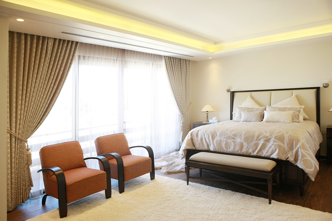 Neutral Master bedroom With Pop Of Beige, Ivory And White