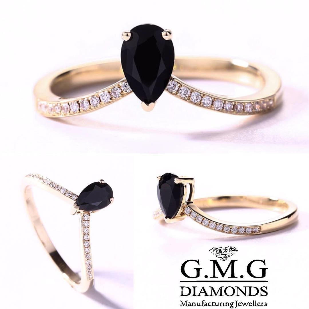 Pear Shaped Black & White Diamond Ring