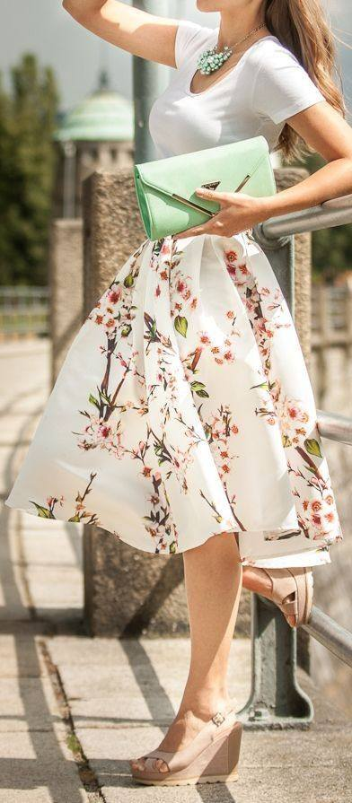 Simple Top With White Floral Skirt And Green Clutch