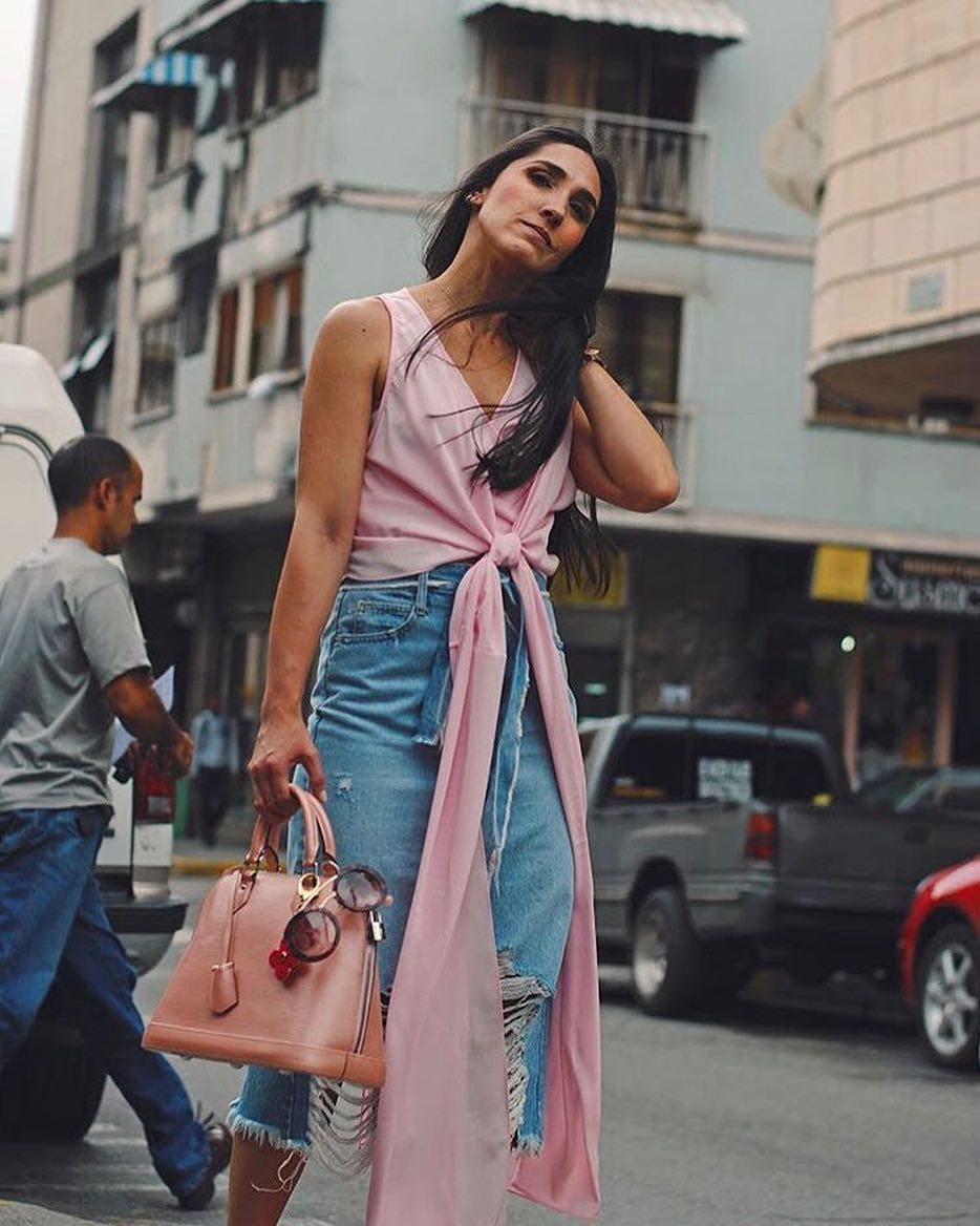 Ultimate Pink Cross Top With Distressed Denim Skirt And Awesome Handbag