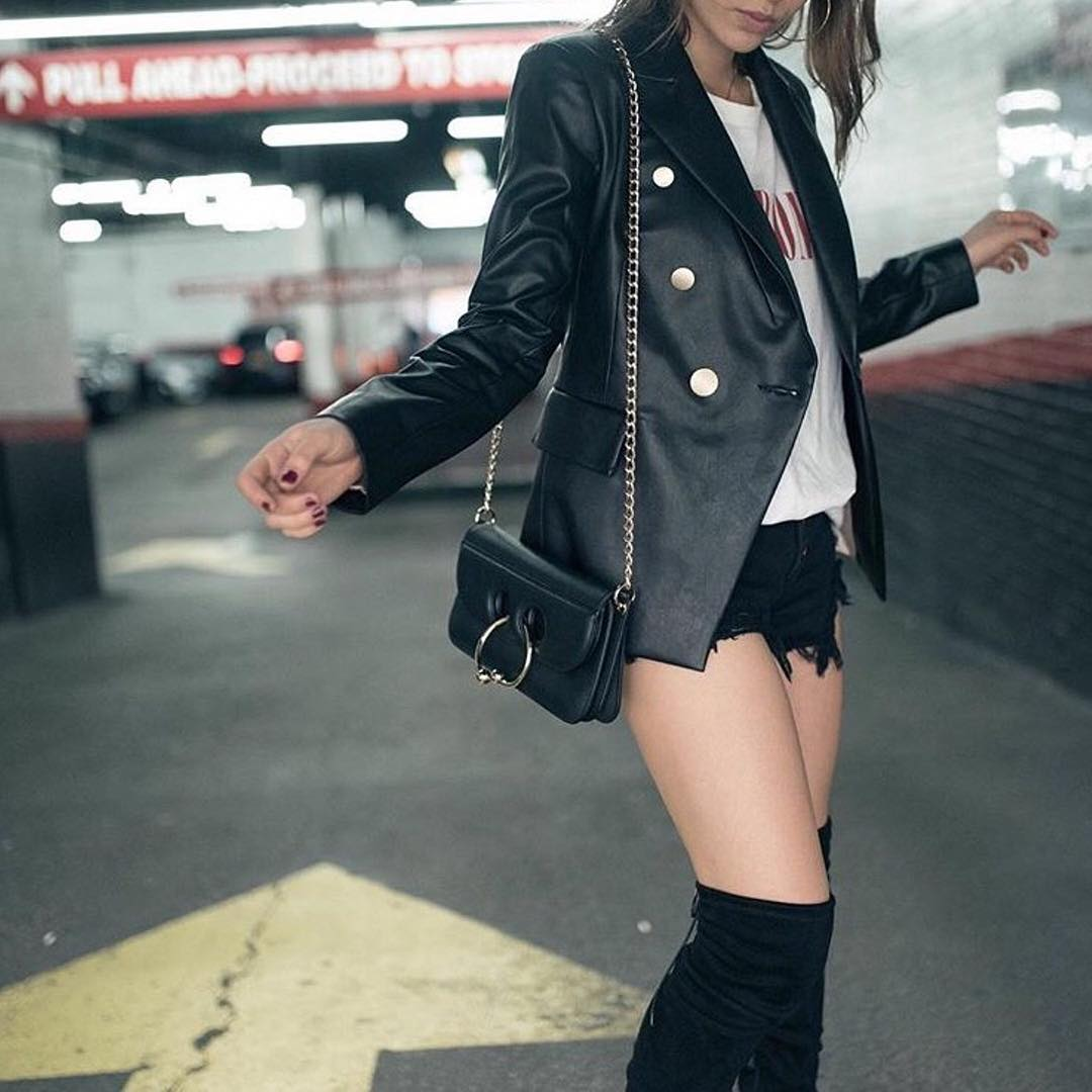 Volatile Black Leather Jacket Paired With Cut Off Shorts And Thigh Shoes