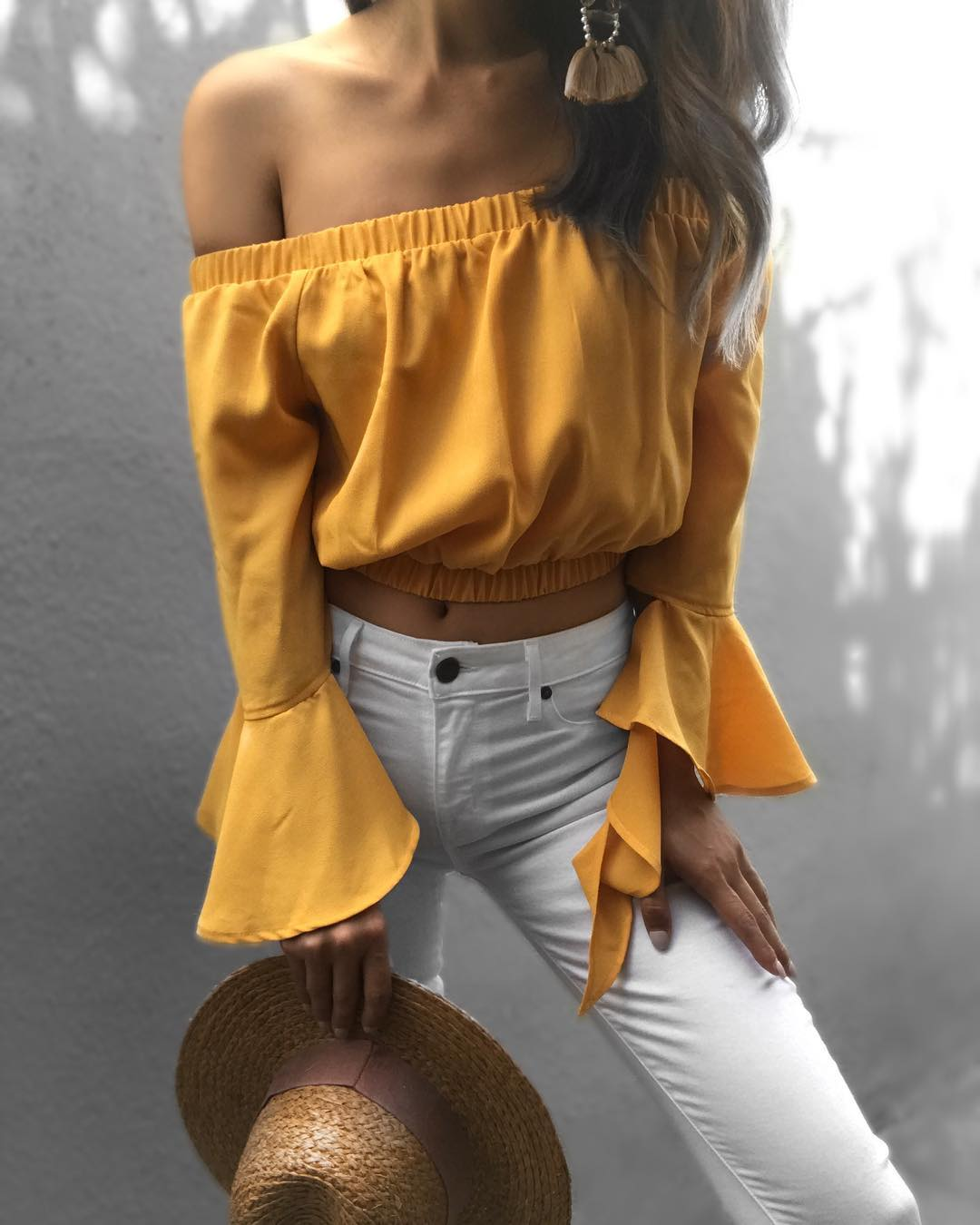 Amazing Off Shoulder Mustard Crop Top With White Denim Jeans And Hat