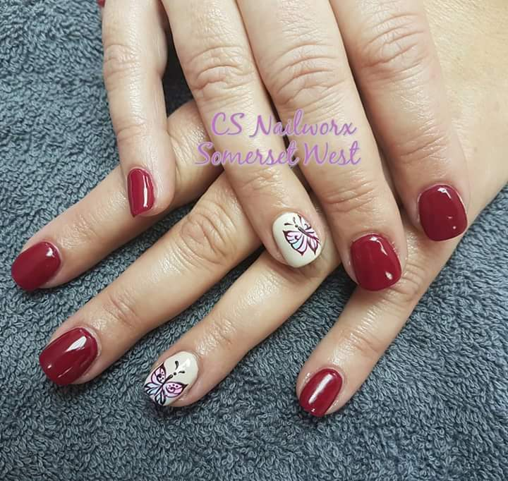Dark Maroon Nail Paint With Butterfly