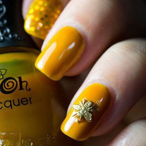 Mustard Yellow Nails With Golden Fly