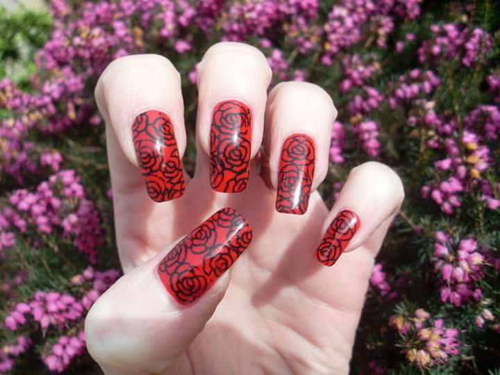 Red Nails With Black Outlined Rose On It