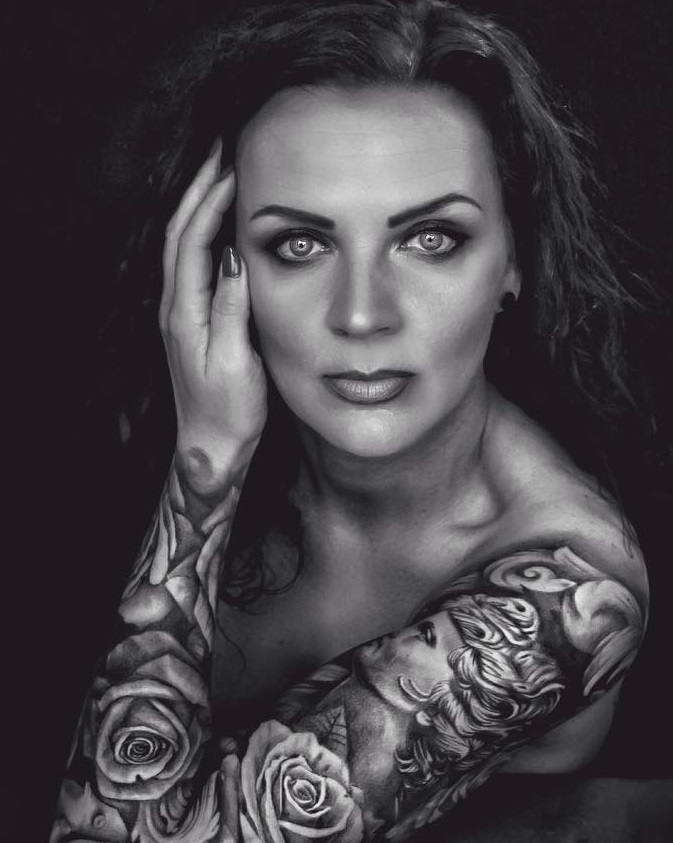 4 black white portrait tattoo with roses inked on full sleeve pic originally posted we via