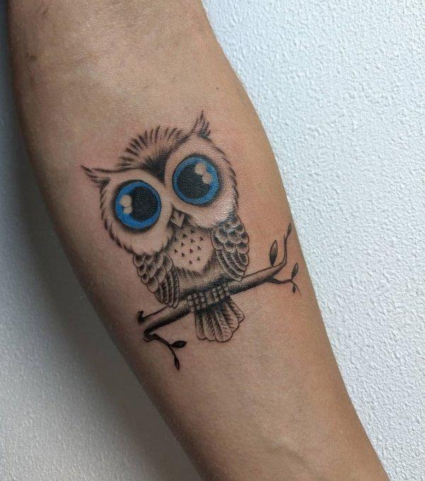 e84de873d9cb6 Feminine Blue Eyes Owl Tattoo on Forearm - Blurmark