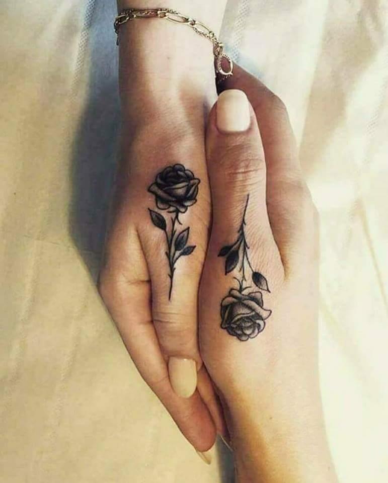 Gorgeous Black And White Rose Tattoo On Thumb Blurmark